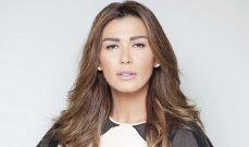بالصور - نادين الراسي تخطف أنظار المتابعين بإطلالتها بالمايوه الأسود