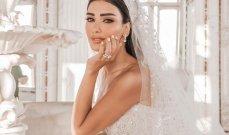 فستان زفاف جيسيكا عازار ملكي.. وجمالها خطف الأنظار - بالصور