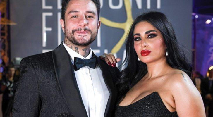 فيديو حميم لـ أحمد الفيشاوي وزوجته وهما يقبلان بعضهما البعض علناً